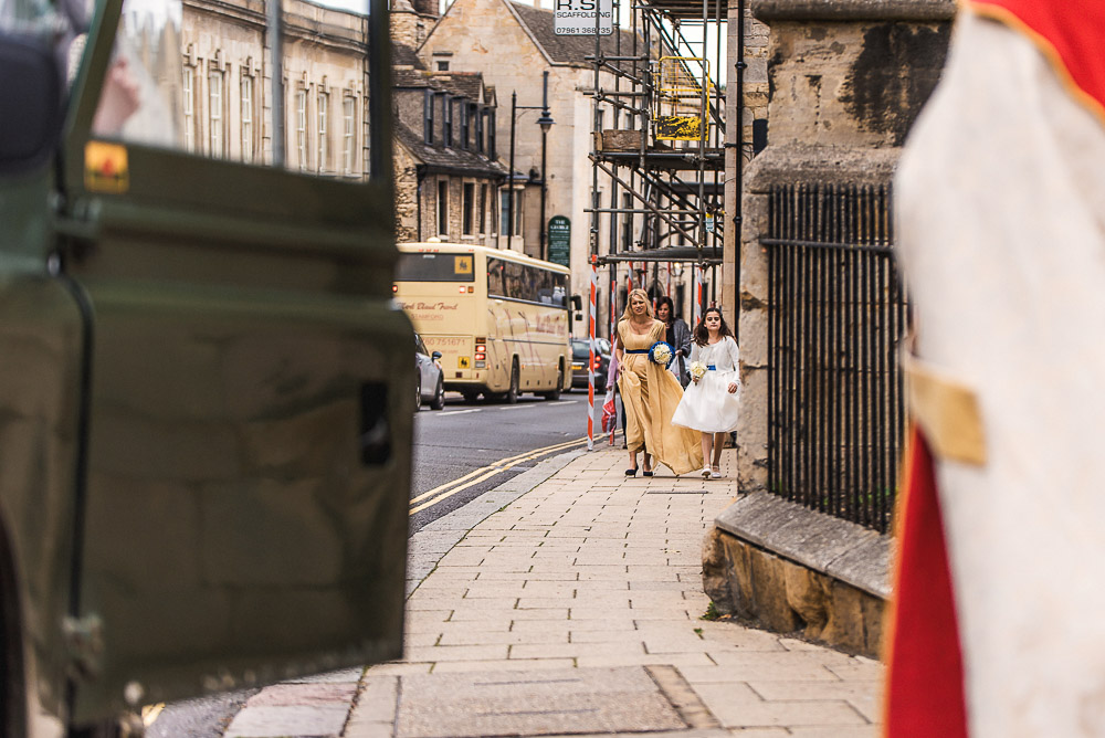 bridesmaid walking up street
