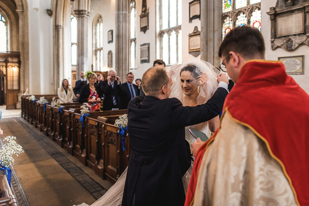 groom removing veil