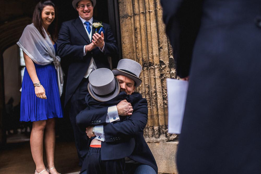 groom hugs pageboy