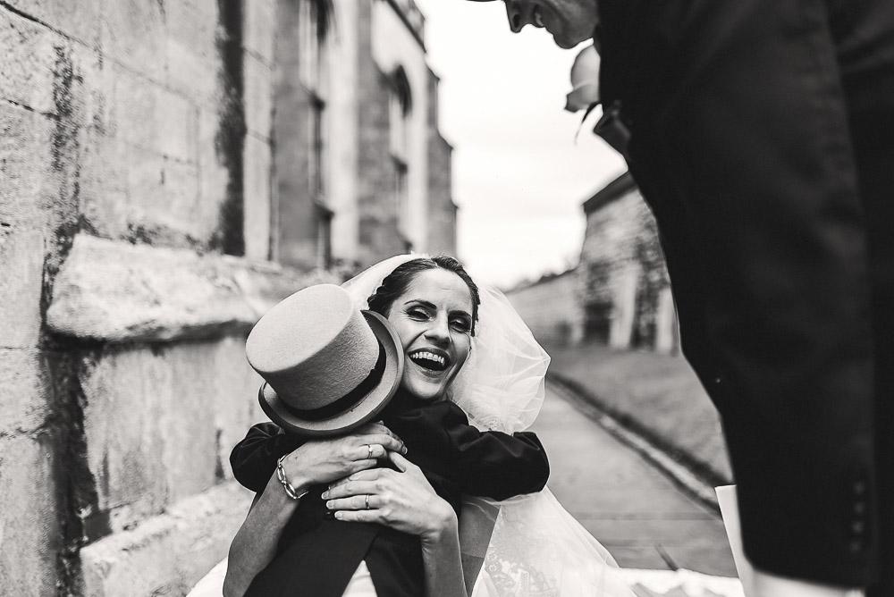 bride hugs pageboy