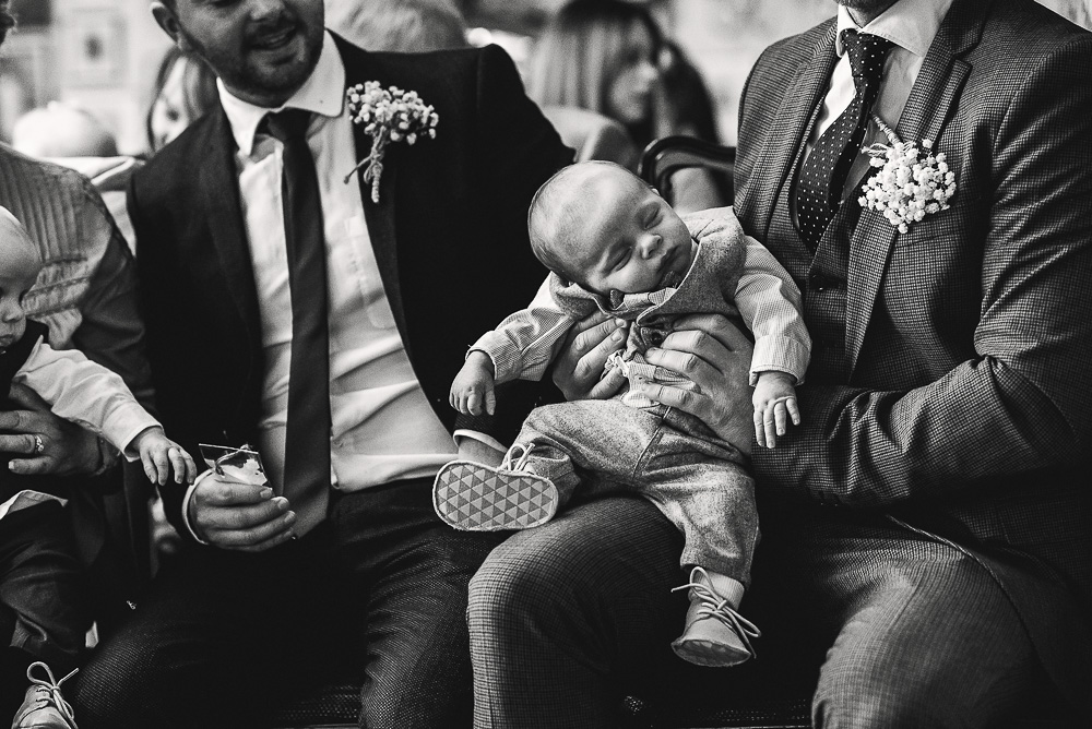 sleeping baby wedding guest