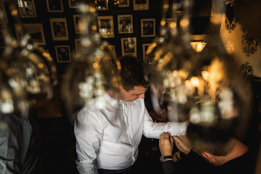 groom cufflinks fasten