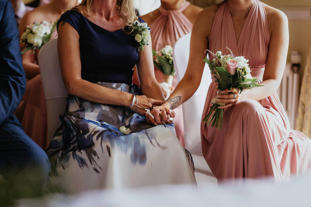 mother of bride holding hands