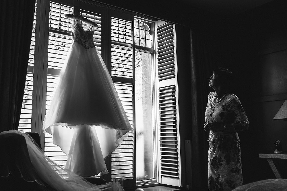 mother of the bride admiring wedding dress