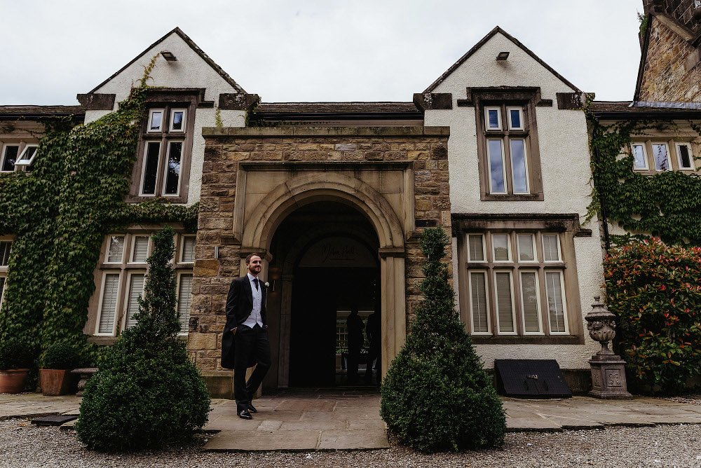 groom waiting outside Mitton Hall