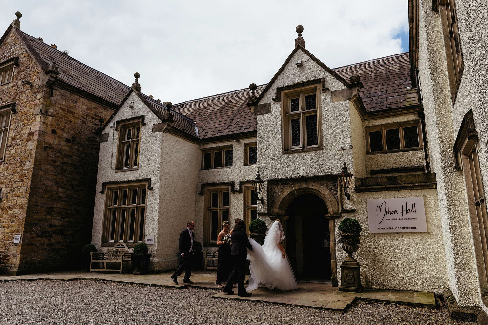 bride entering Mitton Hall