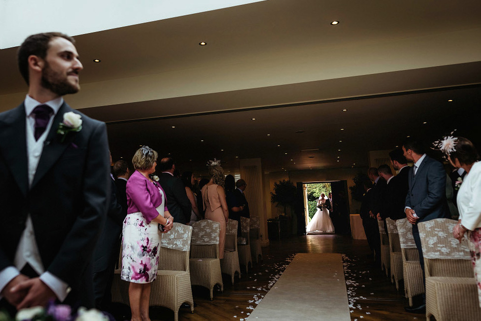 bride entering ceremony room at Mitton Hall