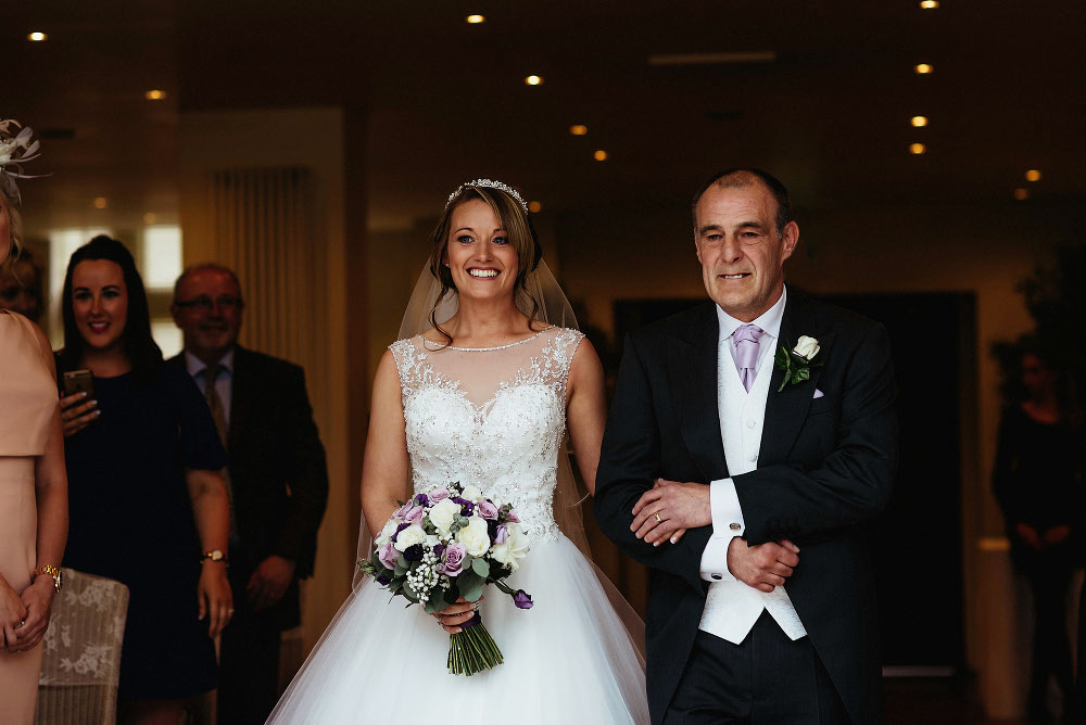 bride linking arms with her dad