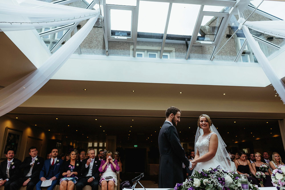 bride and groom say wedding vows