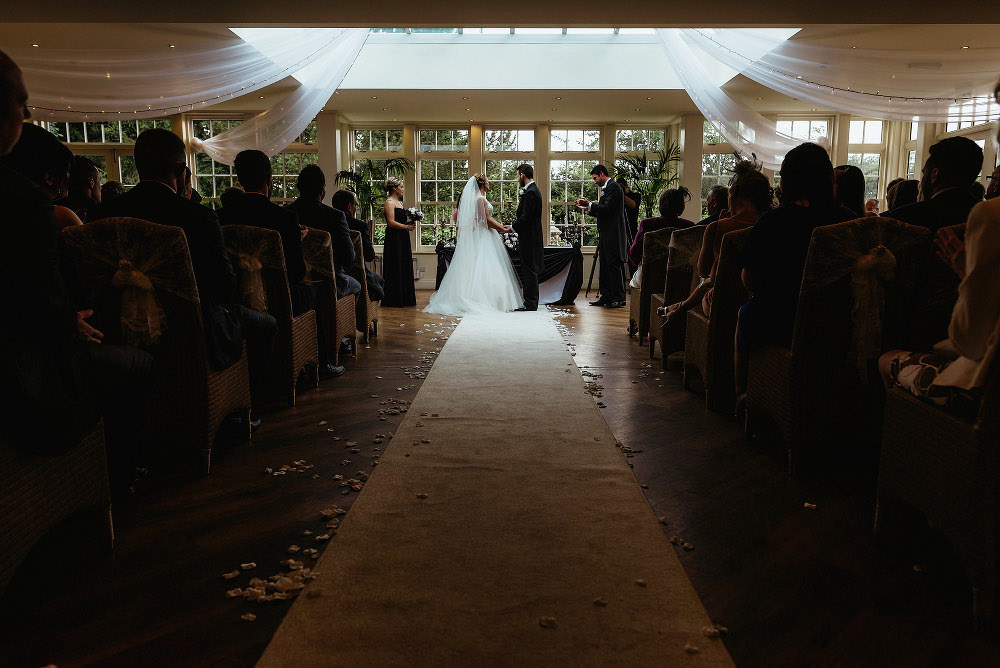 the wedding ceremony inside Mitton Hall hotel