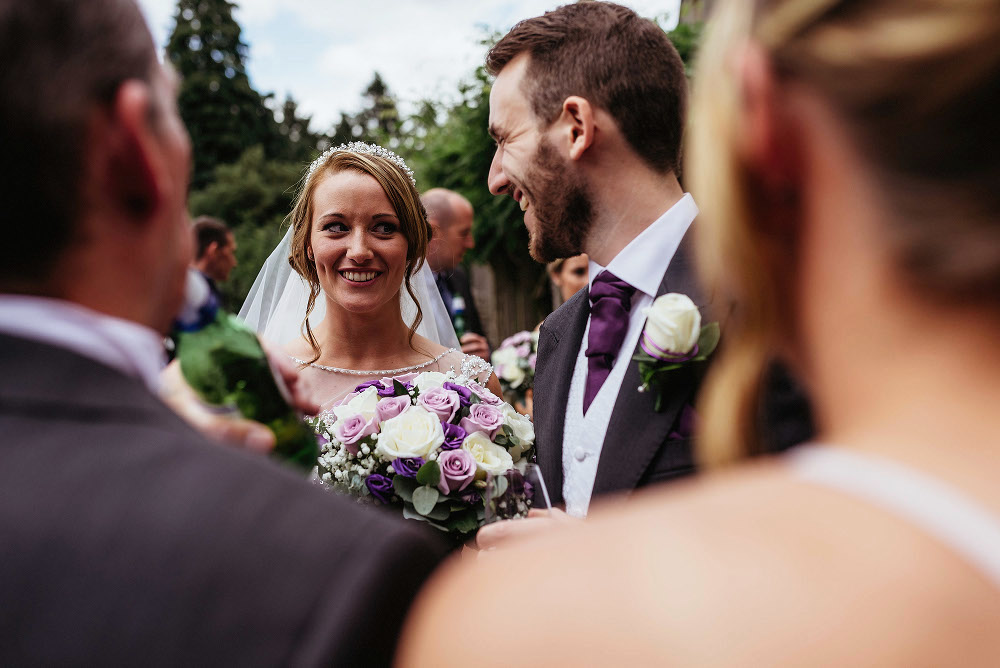 bride smiling at guests