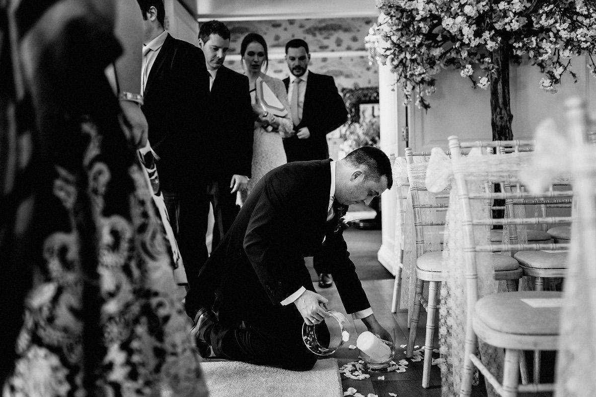 groomsman breaks vase