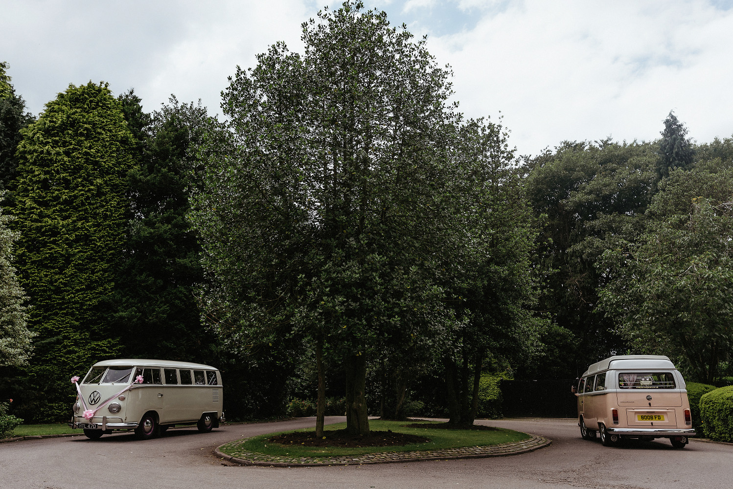 vintage camper vans arrive at wedding venue