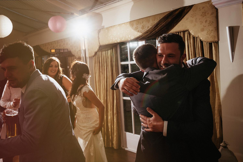 groomsman hugging groom