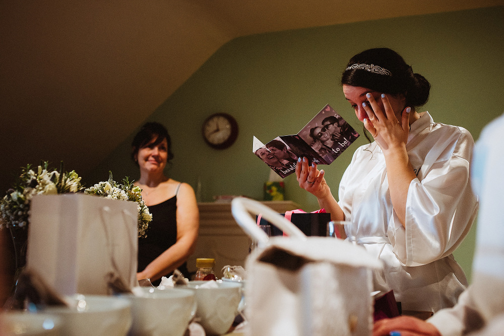 bride reading card crying