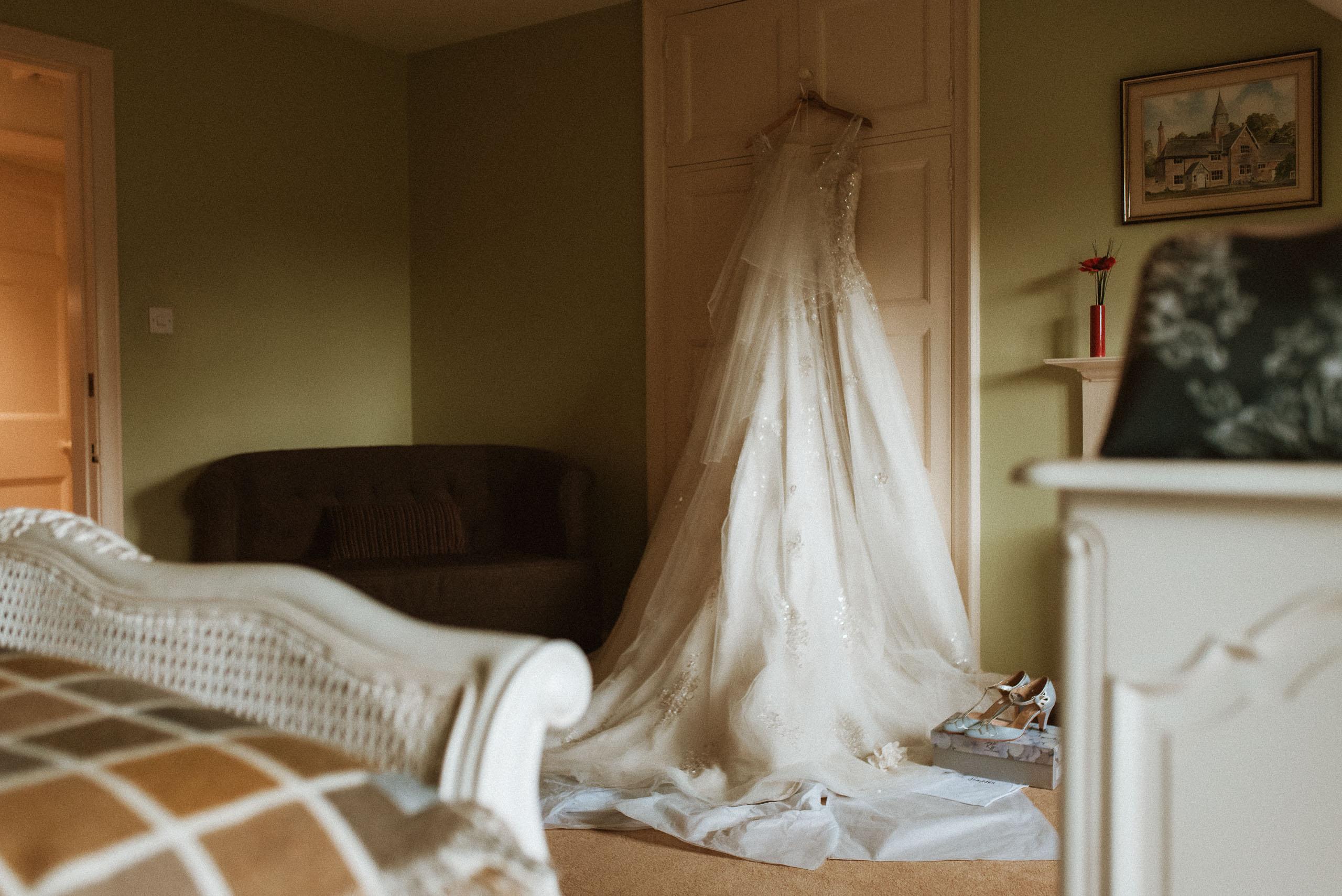 wedding dress hanging up at Abbeywood Estate
