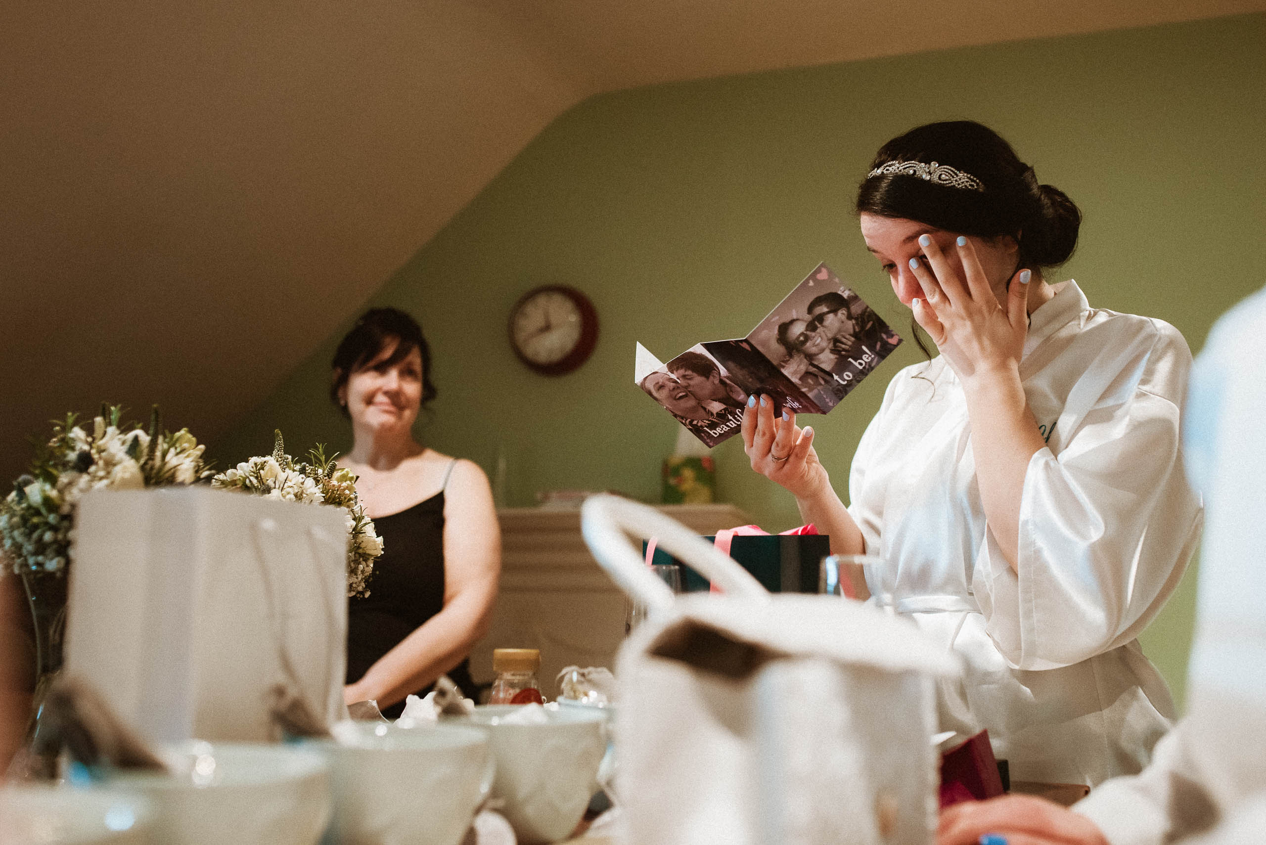 bride wipes away tear as she reads letter
