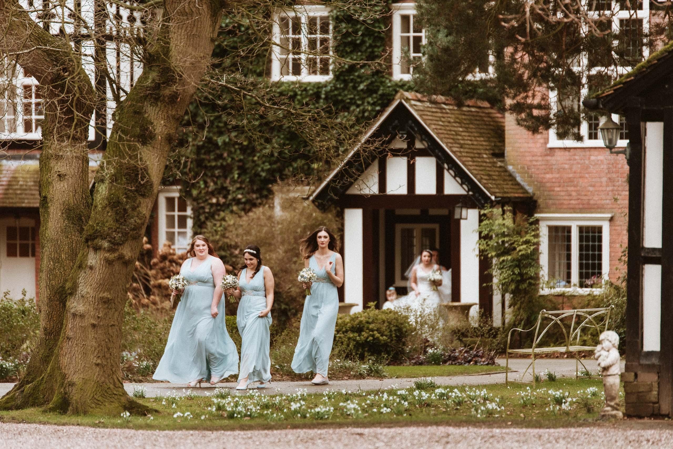 bridal party leaving Abbeywood Estate manor