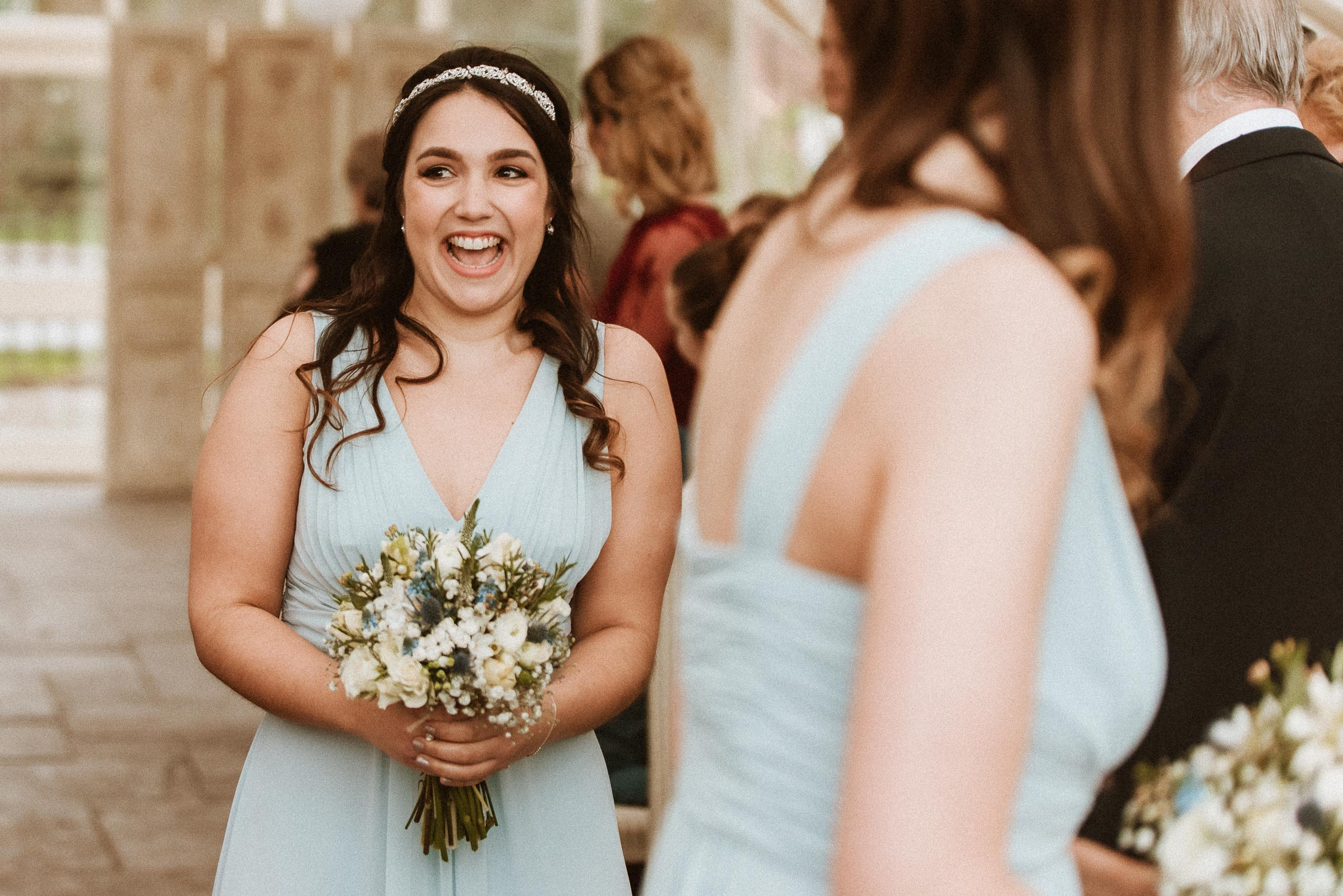 excited bridesmaid in blue dress