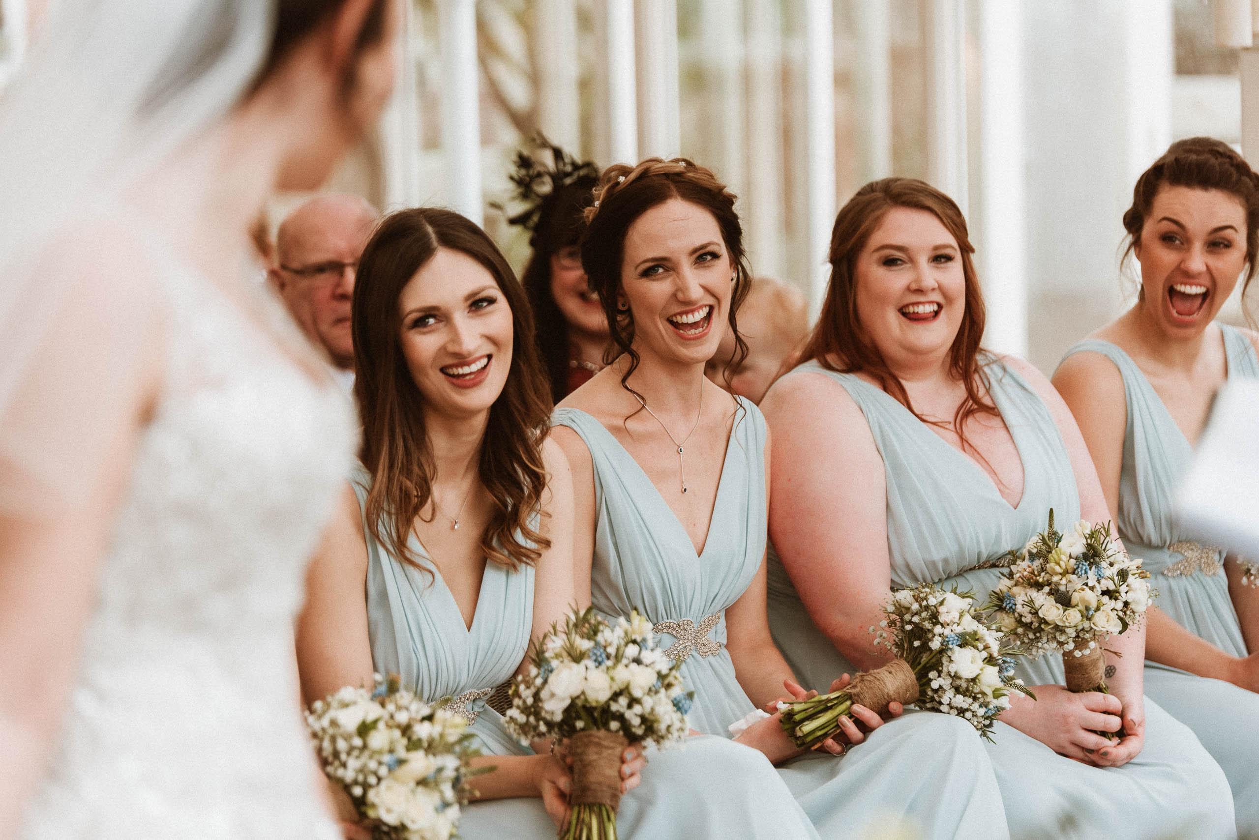 bridesmaids all smiling