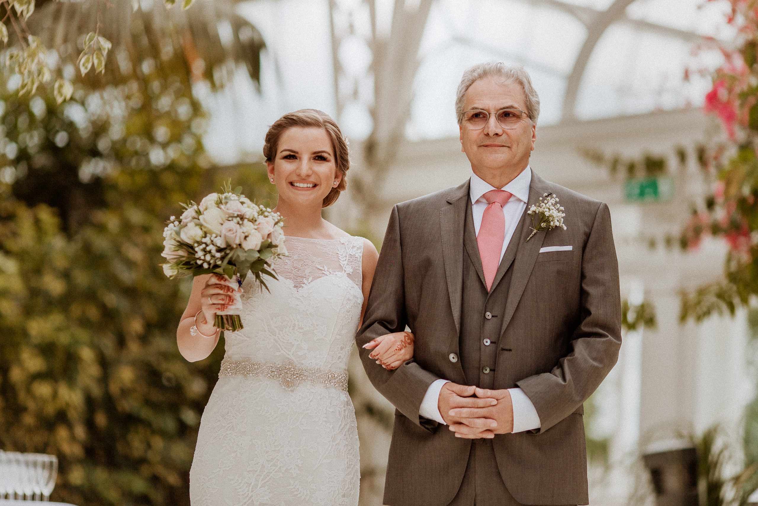 father of the bride and bride linking arms