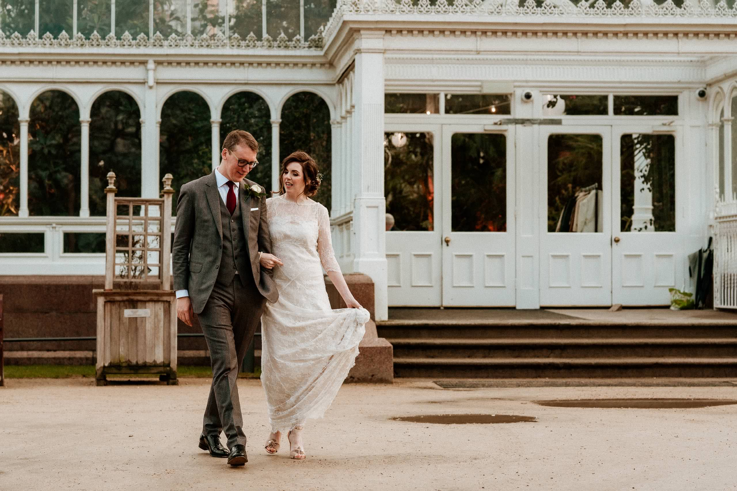 bride and groom outside Sefton palm house