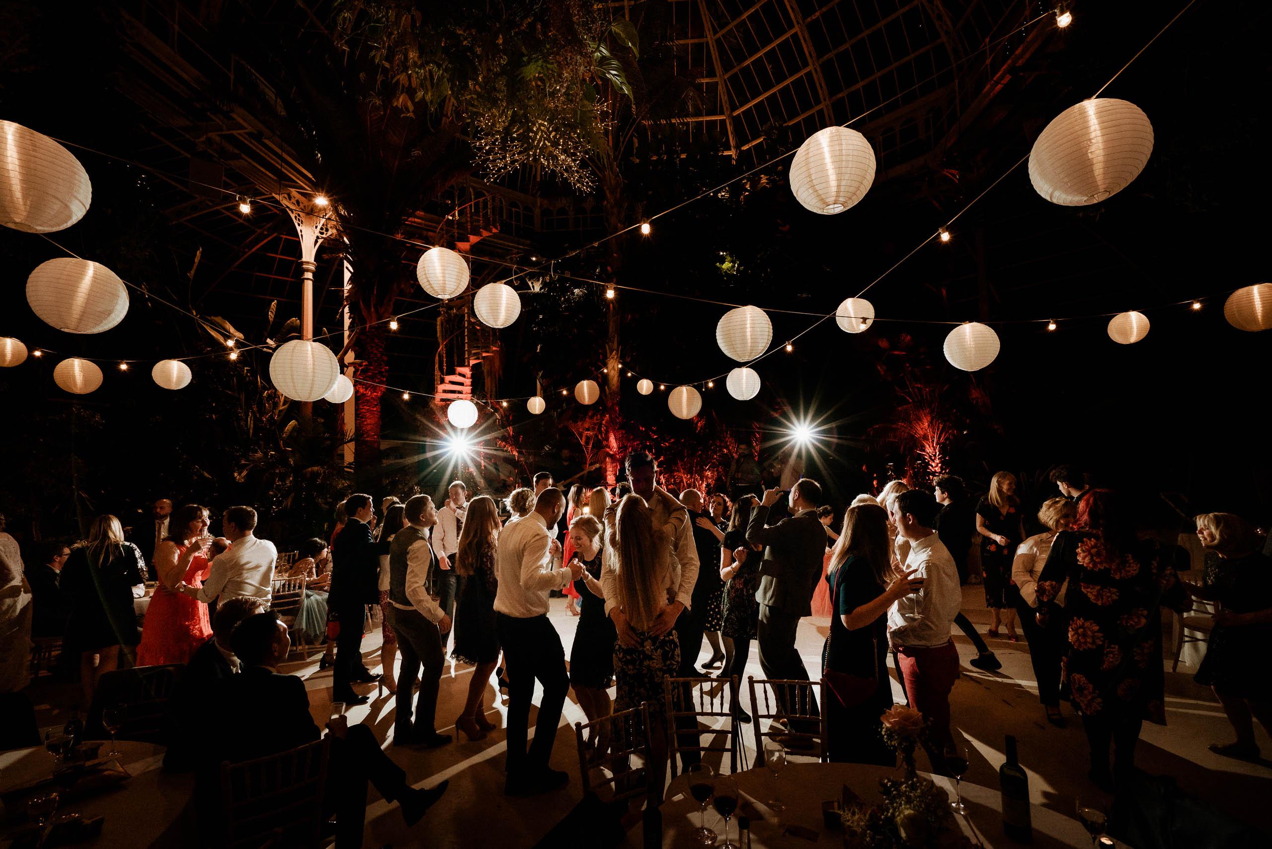 wedding guests dancing under paper lanterns