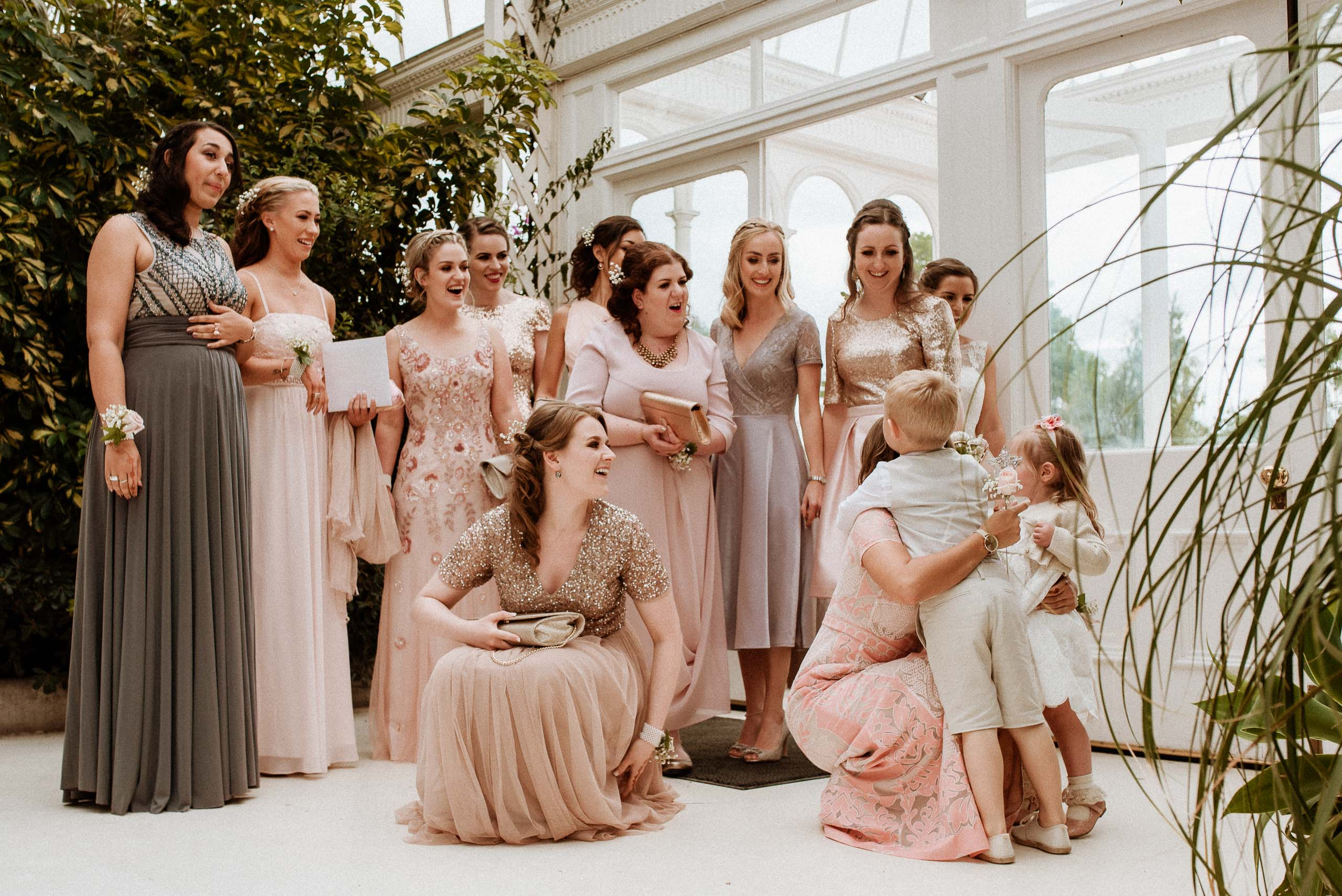 lots of bridesmaids greeting a pageboy
