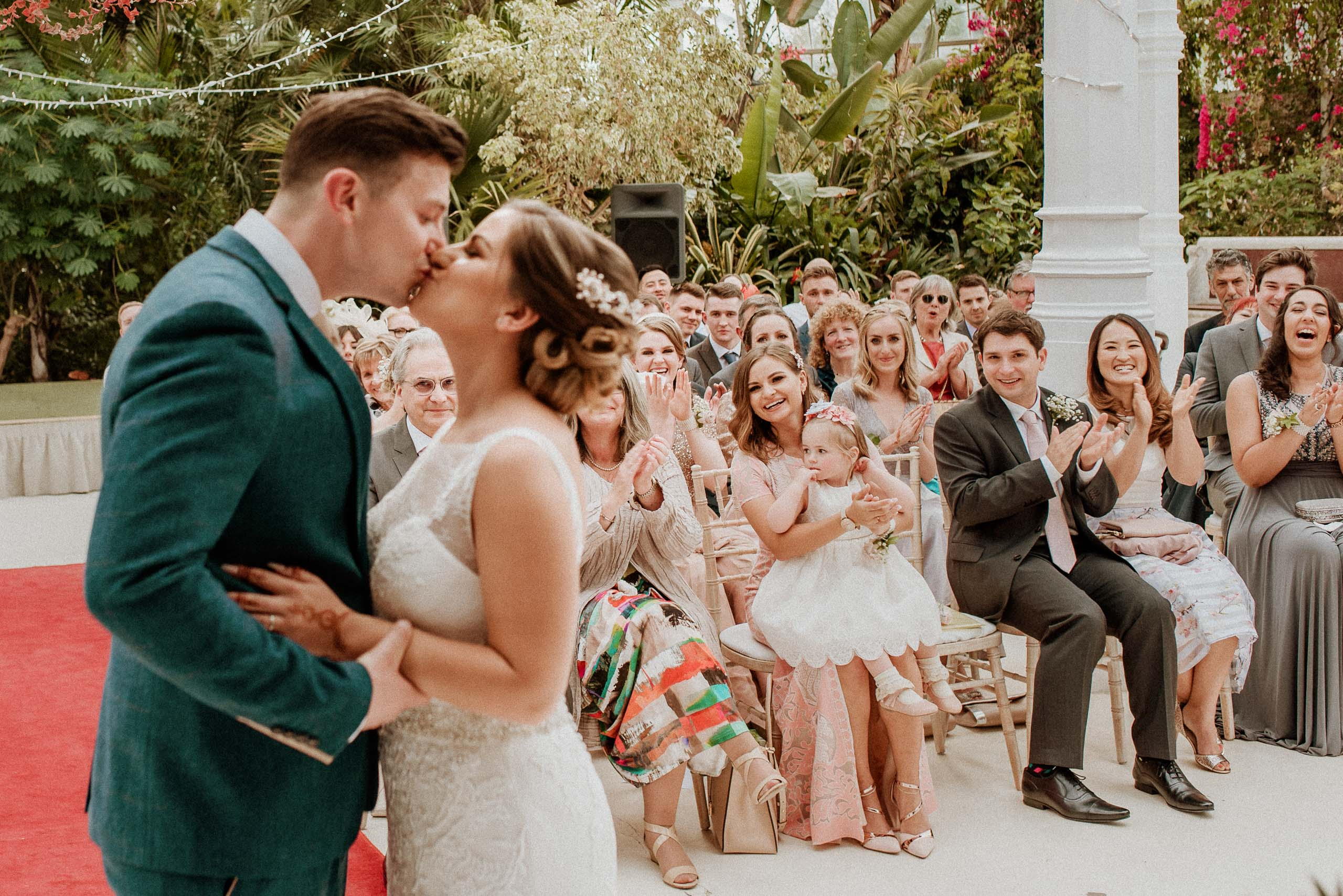 wedding guests cheering the first kiss