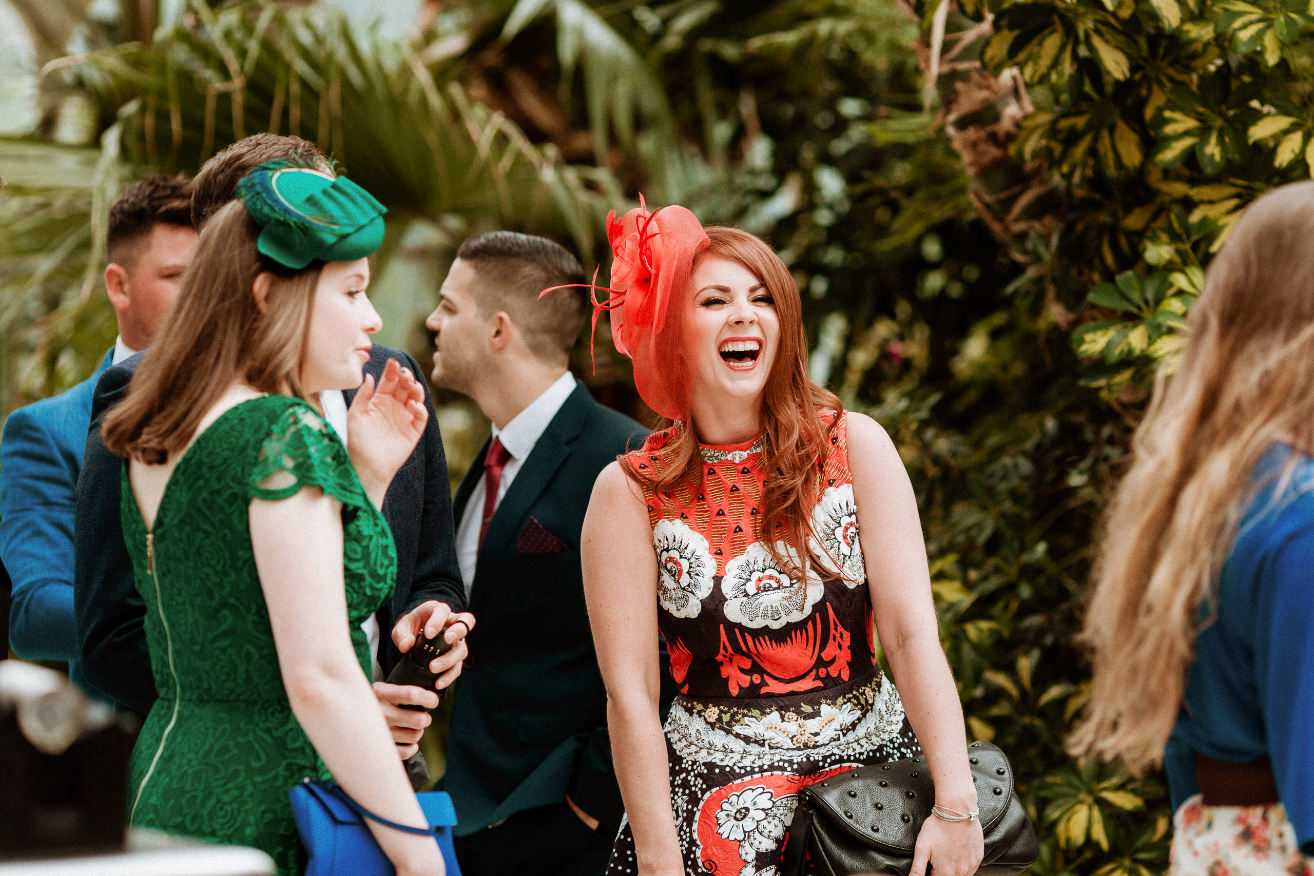 laughing wedding guest with red hair