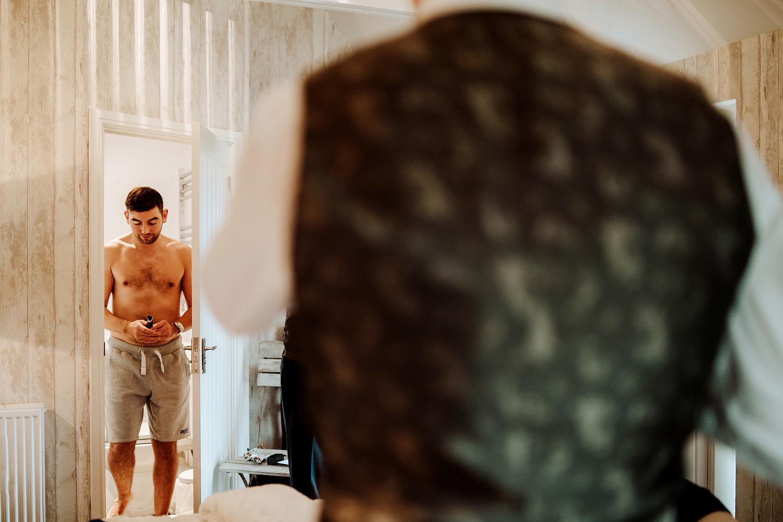 shirtless groom leaving bathroom