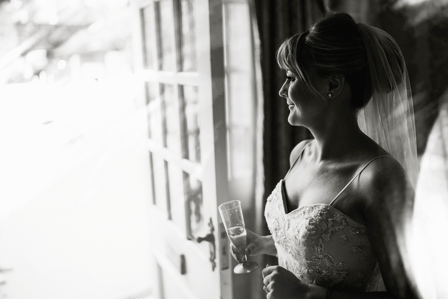beautiful portrait of the bride with champagne