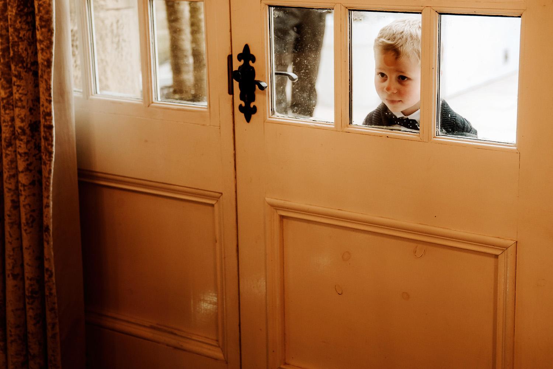 pageboy peeping through window