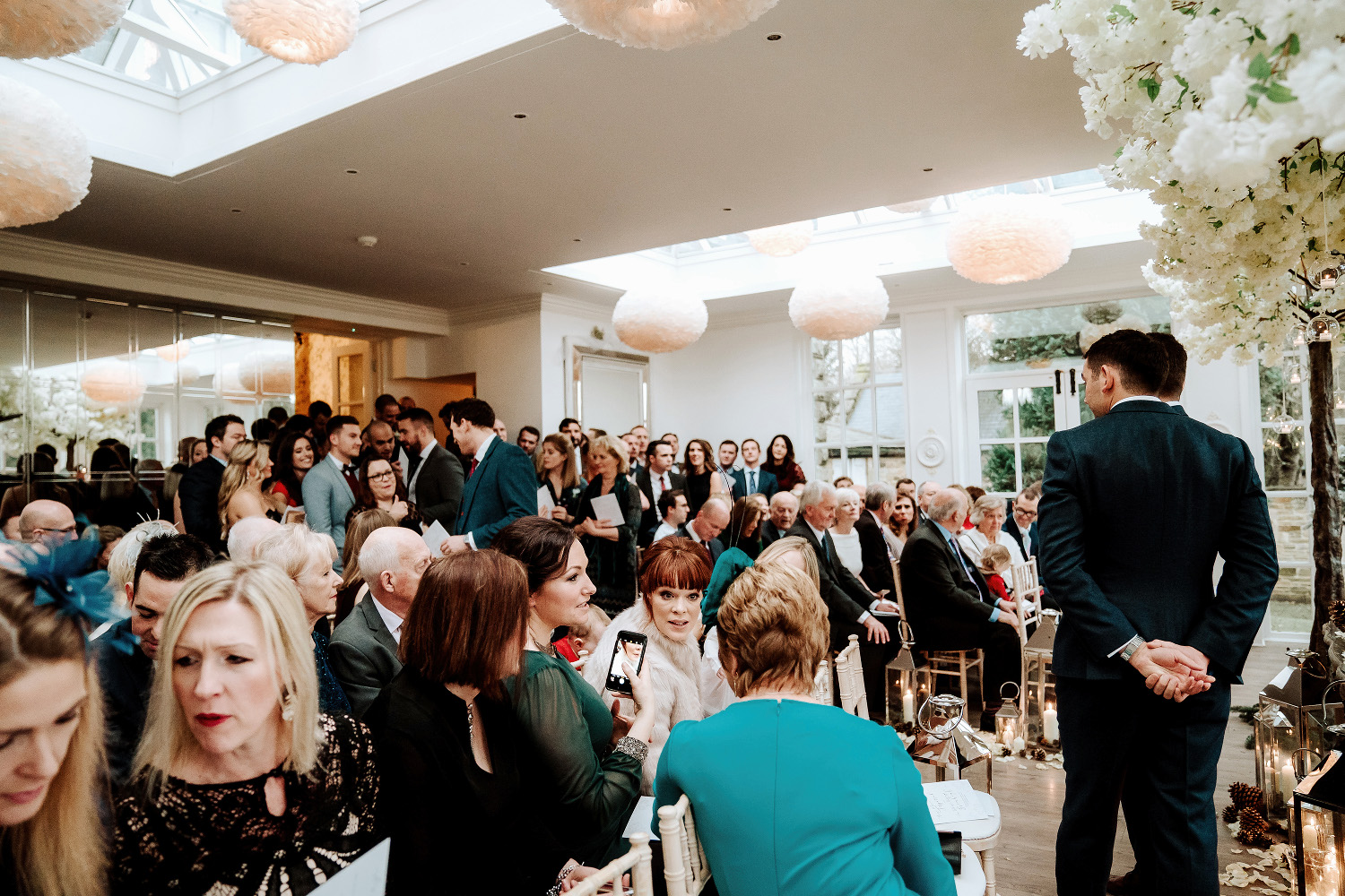 orangery at Woodhill Hall filled with wedding guests