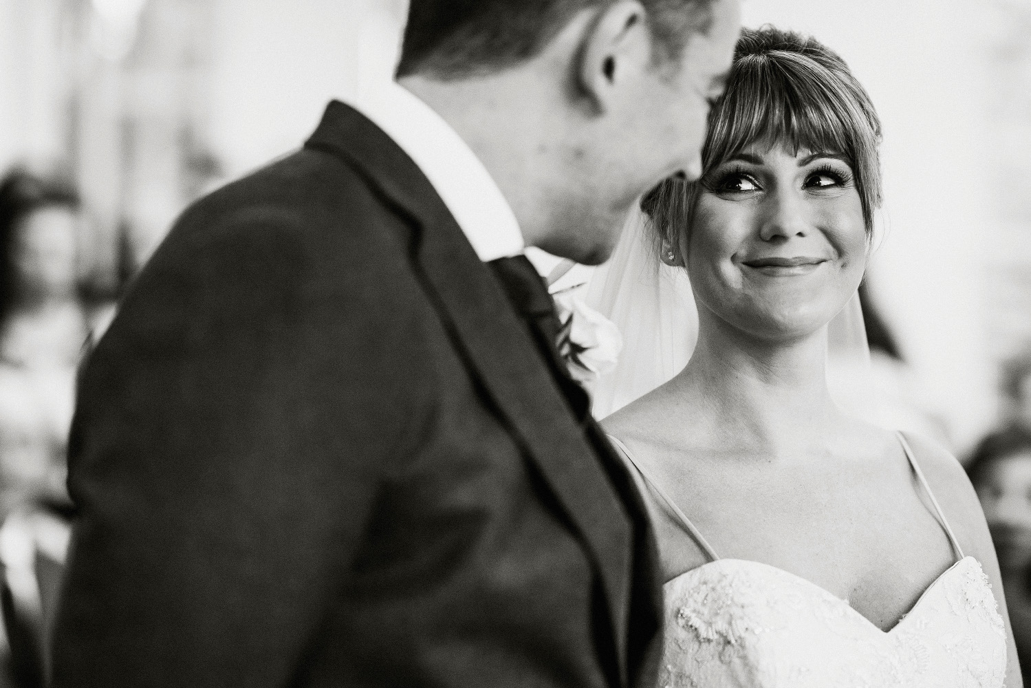 bride glancing at groom and smiling