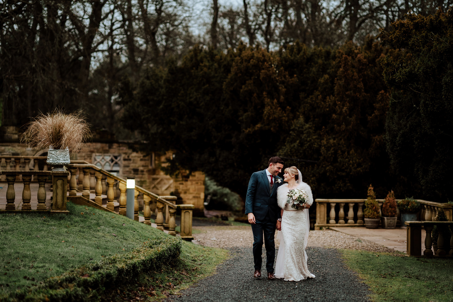bride and groom walking outside Woodhill Hall