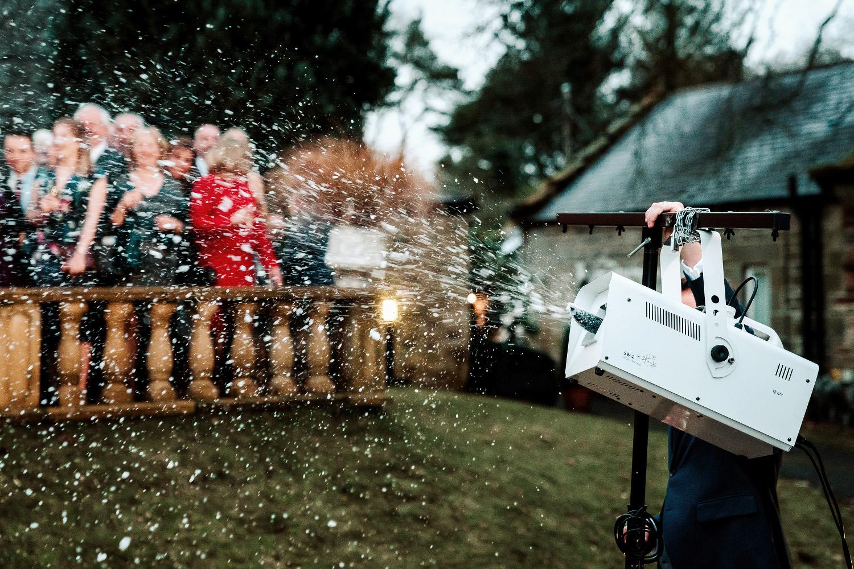 groomsman operates snow machine