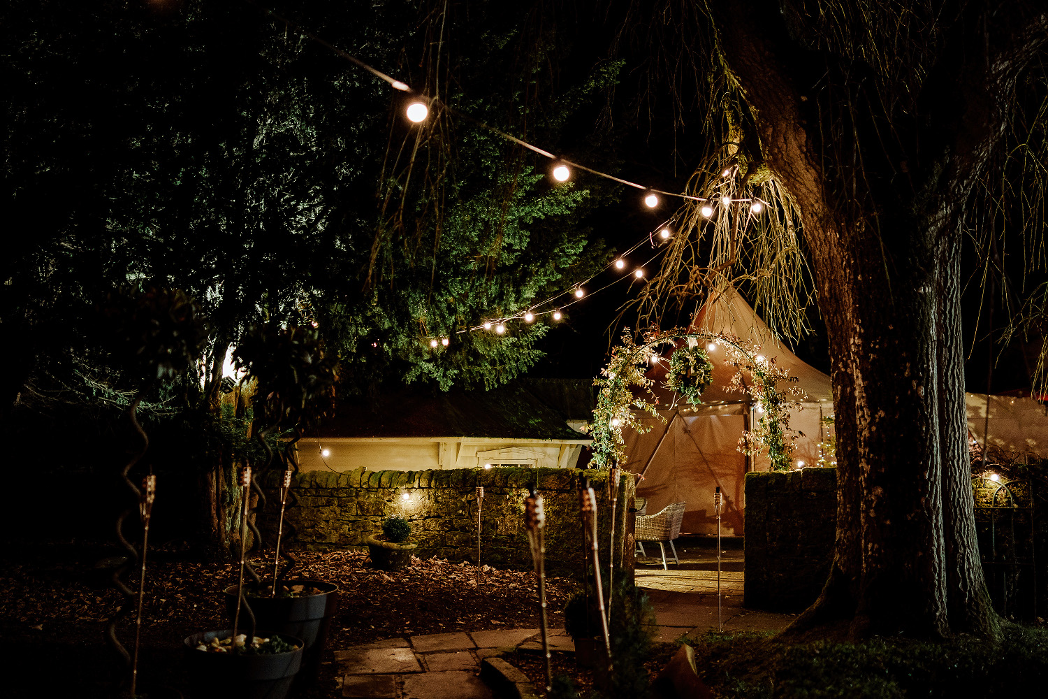 tepee lit up by fairylights