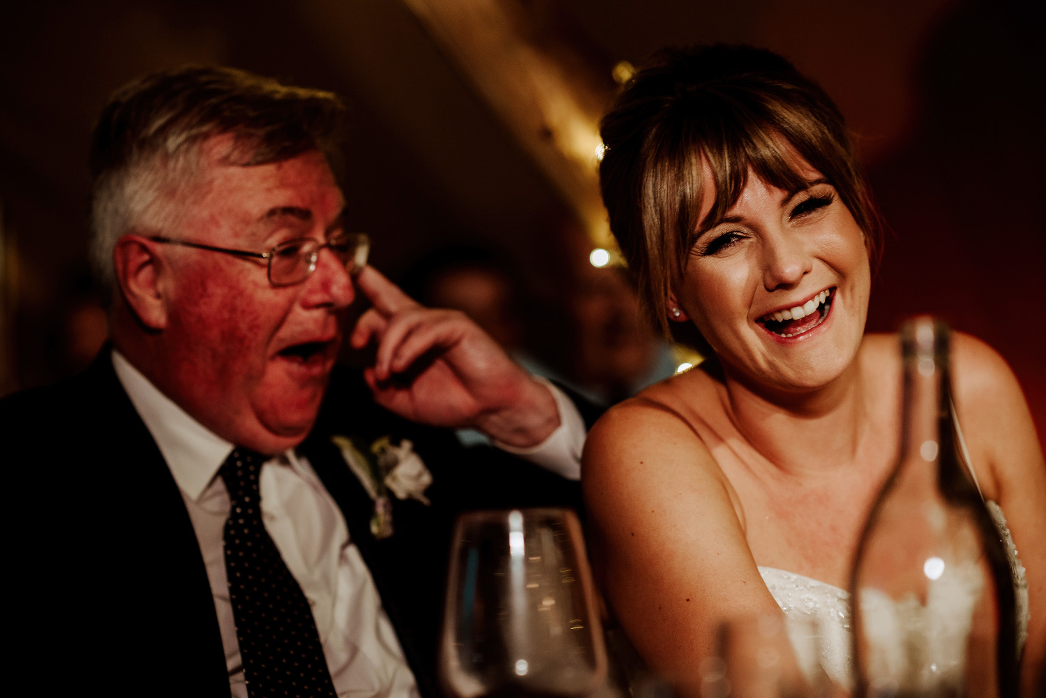 bride and her dad crying with laughter