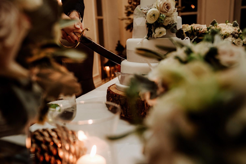 military style knife cuts wedding cake