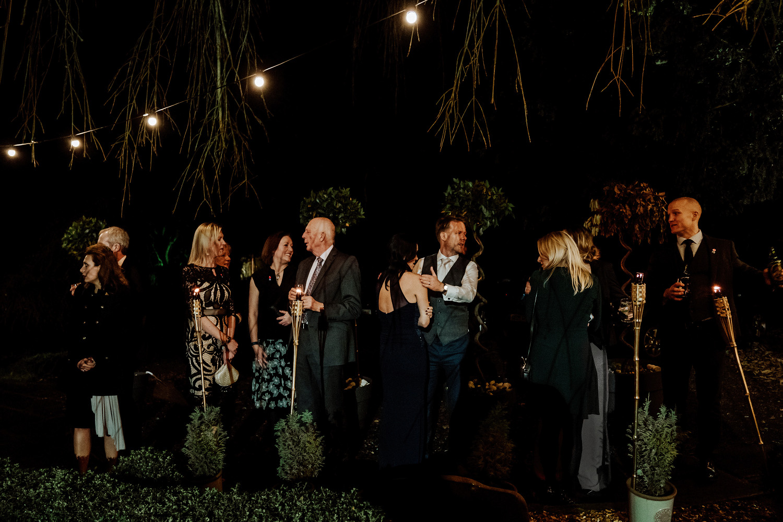 wedding guests stood outside in dark