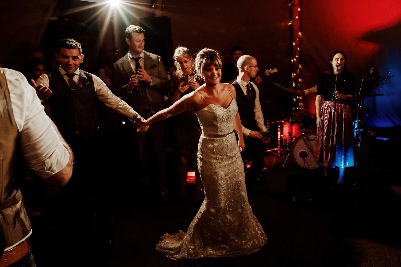 bride drags groom onto dancefloor