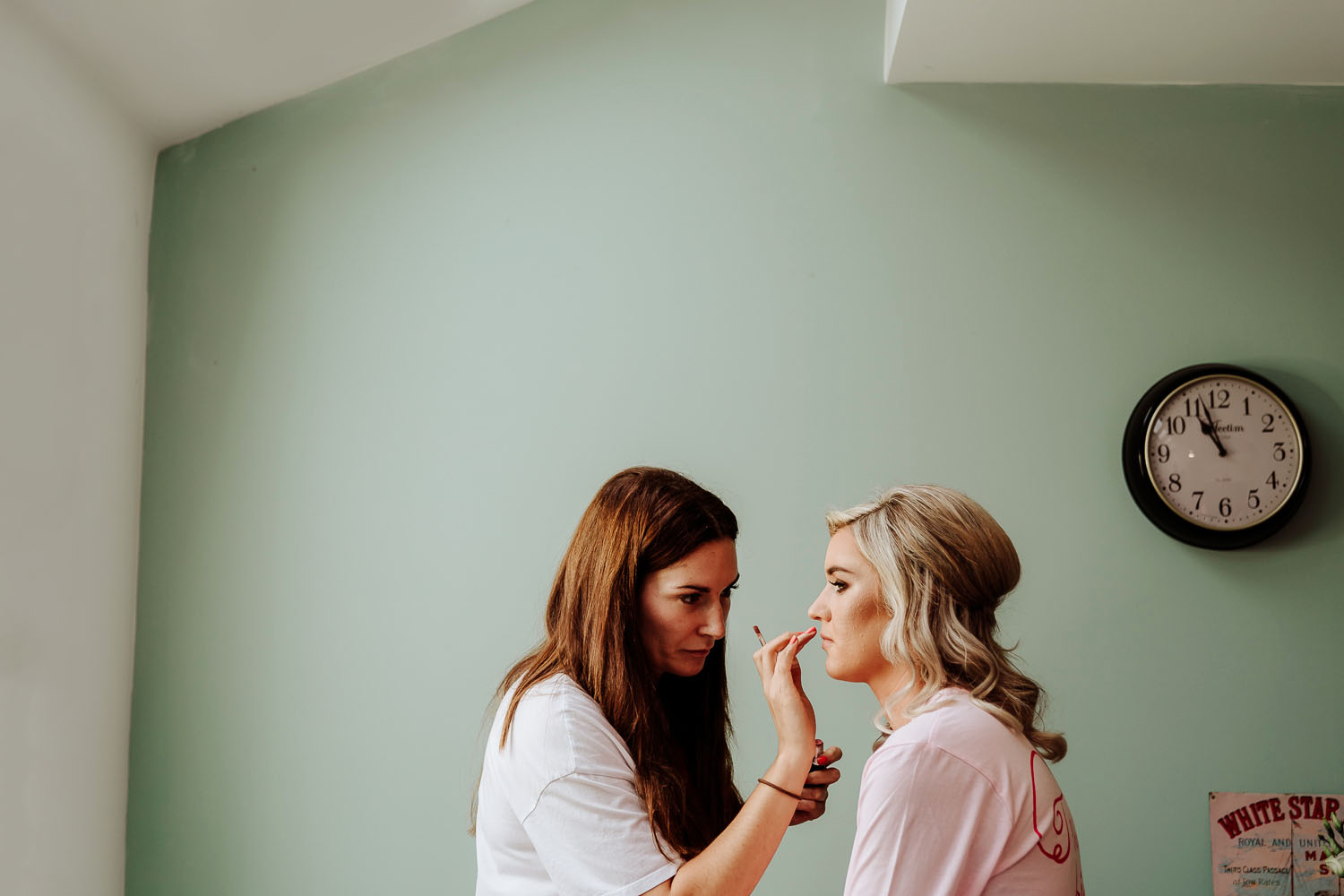 Bridesmaid applies makeup