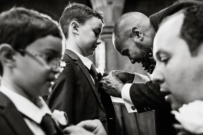 groom fixes pageboy tie
