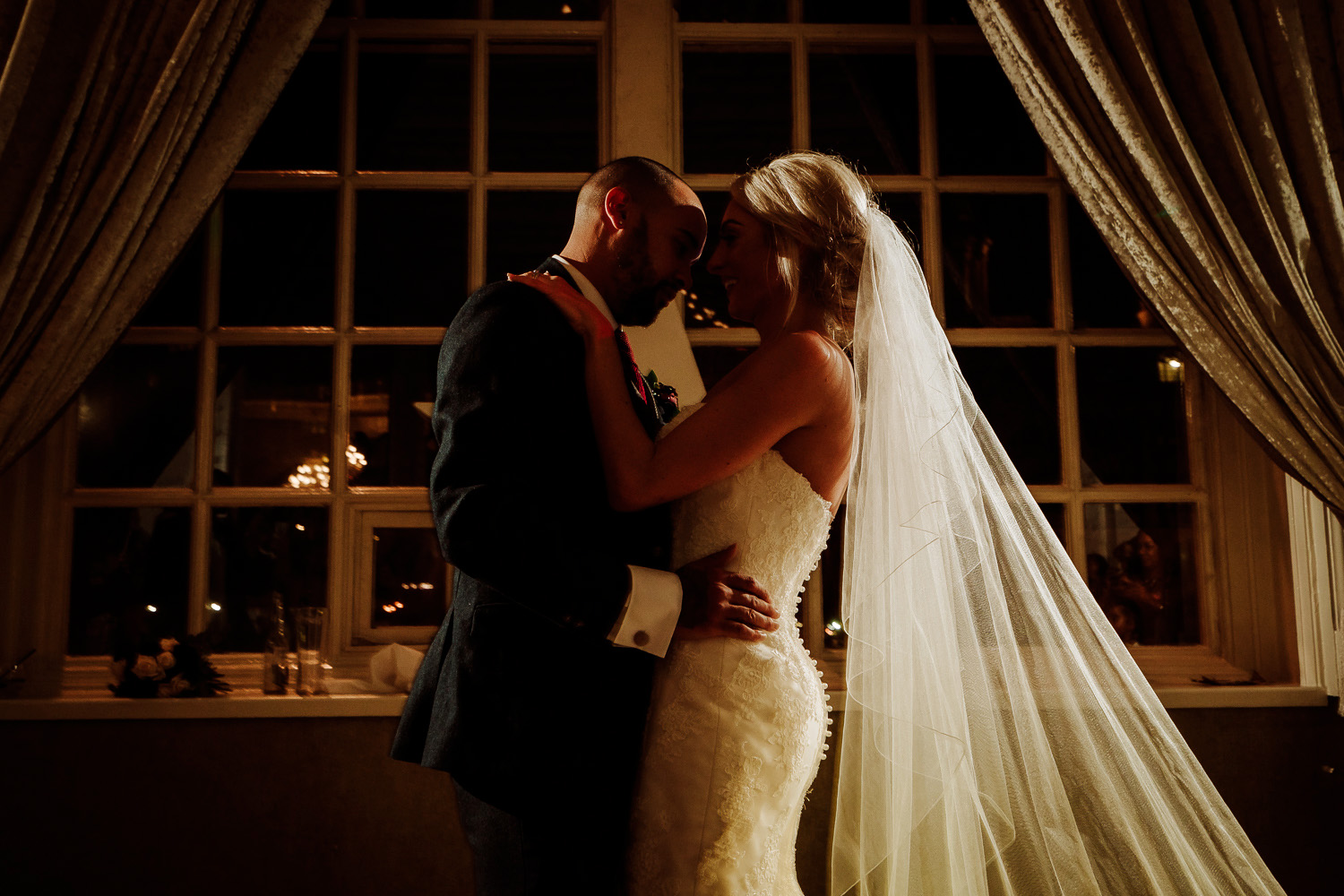 bride and groom close together for first dance