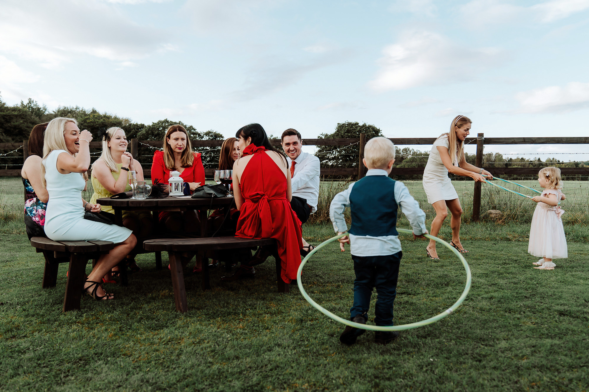 wedding guests sat at picnic table