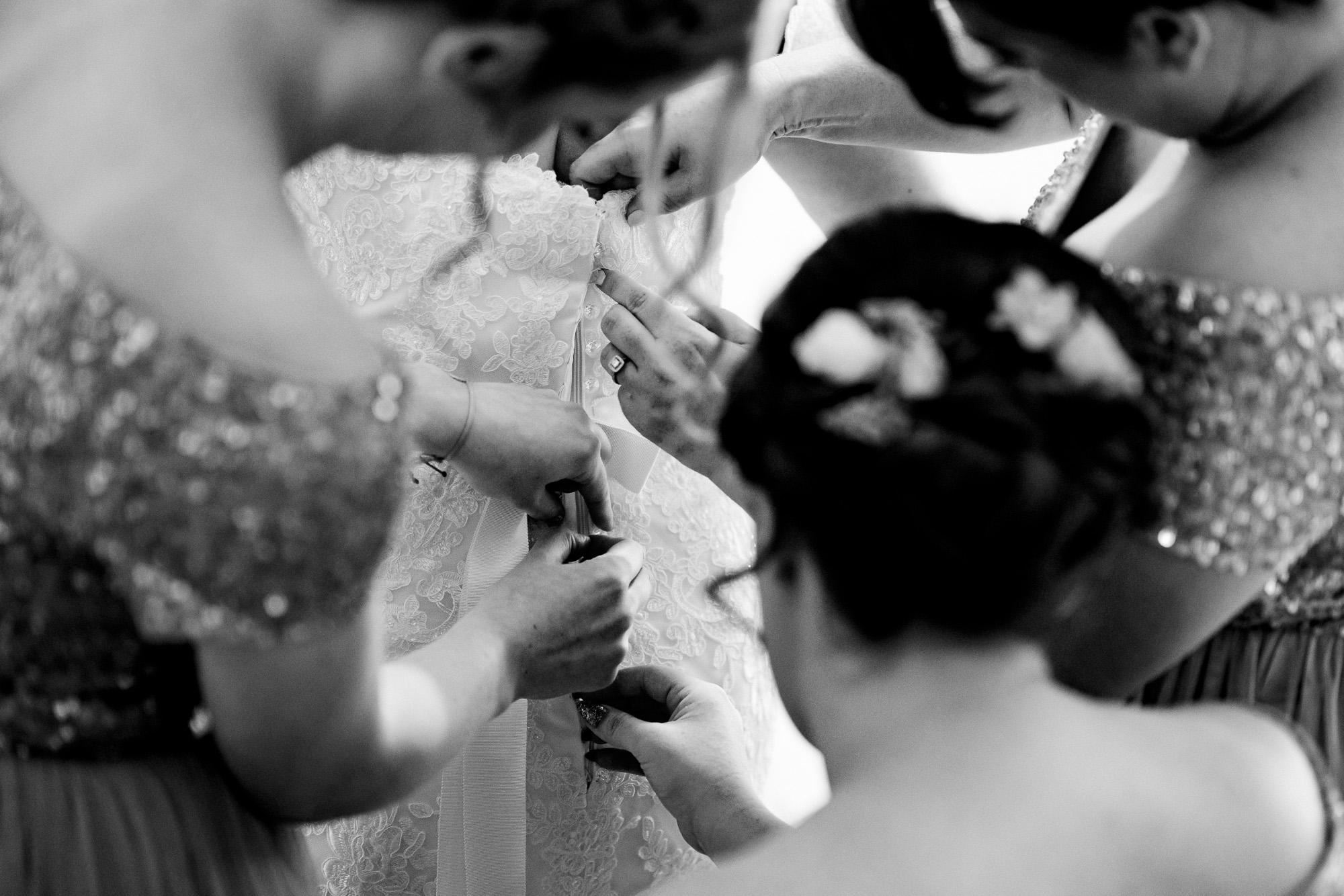 fastening up the wedding dress