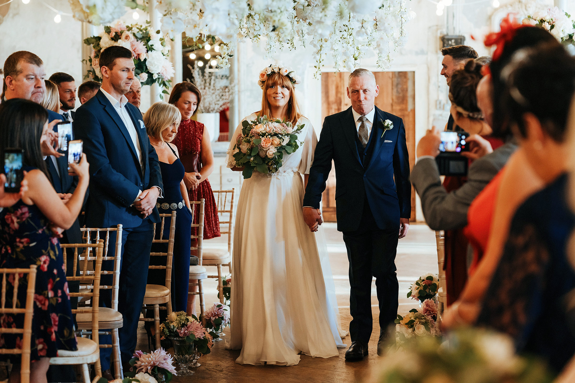 Bride-Walks-Down-Aisle-At-Holmes-Mill-Wedding