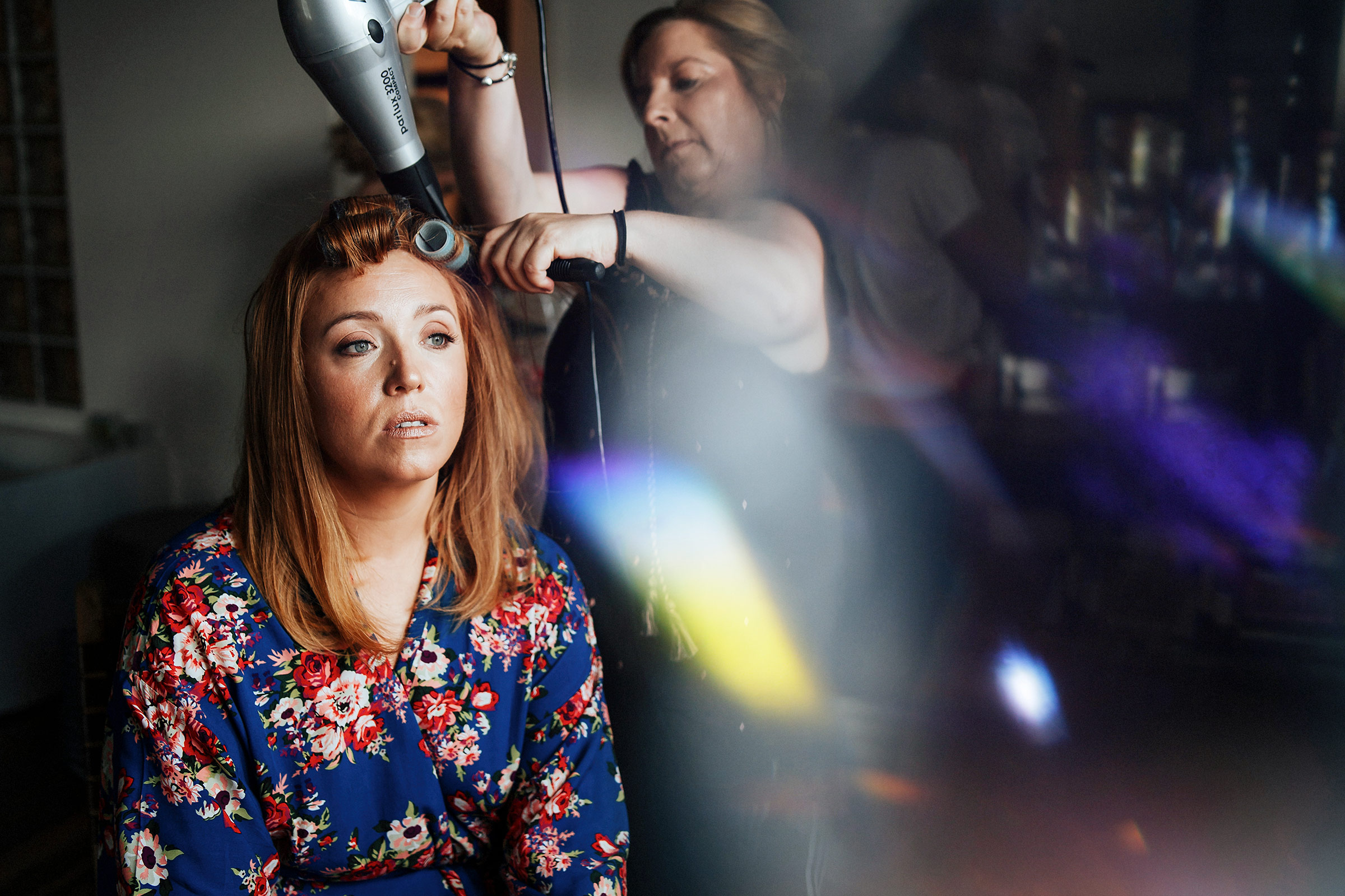 Bride-gets-hair-fixed-in-bridal-suite
