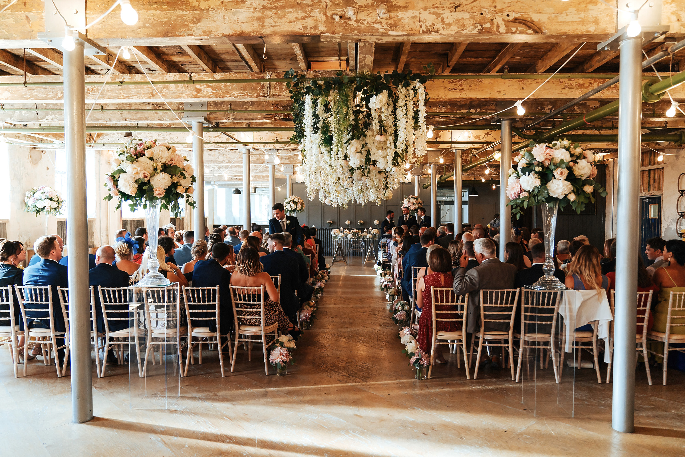 Holmes Mill function room with wedding guests